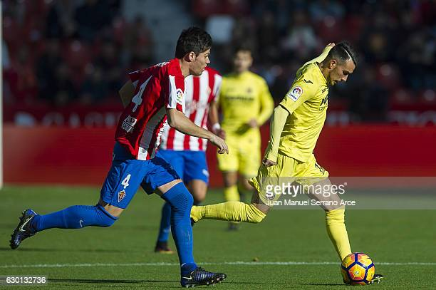 Nicola Sansone of Villarreal CF duels for the ball with Jorge Mere of Real Sporting de Gijon during the La Liga match between Real Sporting de Gijon...