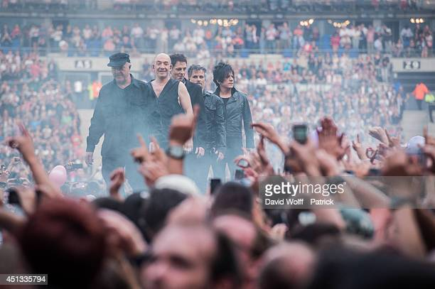 Nicola Sirkis Marco Boris Jardel Oli de Sat and Mr Shoes from Indochine performs at Stade de France on June 27 2014 in Paris France