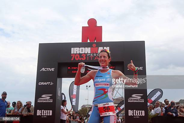 Nicola Spirig of Switzerland celebrates after winning the womens race during the Ironman 703 Pescara on June 12 2016 in Pescara Italy