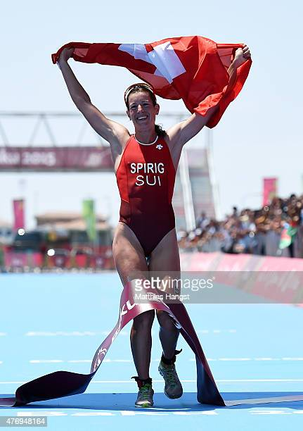 Nicola Spirig of Switzerland celebrates as she crosses the finish line to win the gold medal in the Women's Triathlon Final during day one of the...