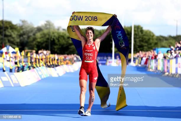 Nicola Spirig of Switzerland celebrates winning gold in the women's triathlon on Day eight of the European Championships Glasgow 2018 at Strathclyde...