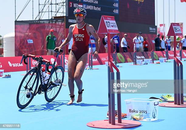 Nicola Spirig of Switzerland dismounts in the Women's Triathlon Final during day one of the Baku 2015 European Games at Bilgah Beach on June 13 2015...