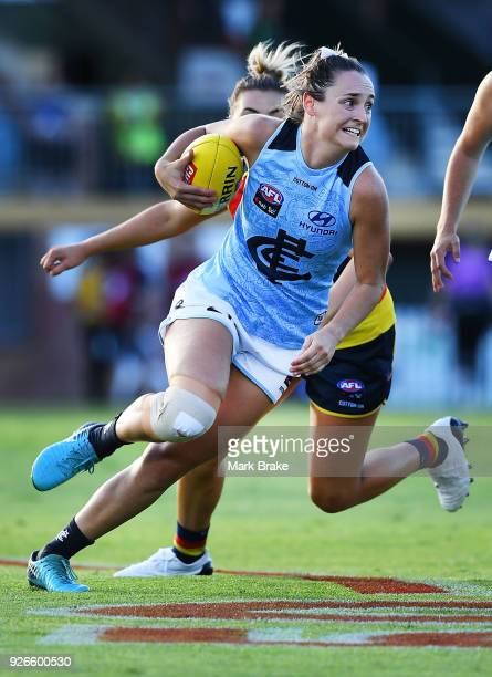 Nicola Stevens of Carlton gets away from Ebony Marinoff of the Adelaide Crows during the round five AFLW match between the Adelaide Crows and the...