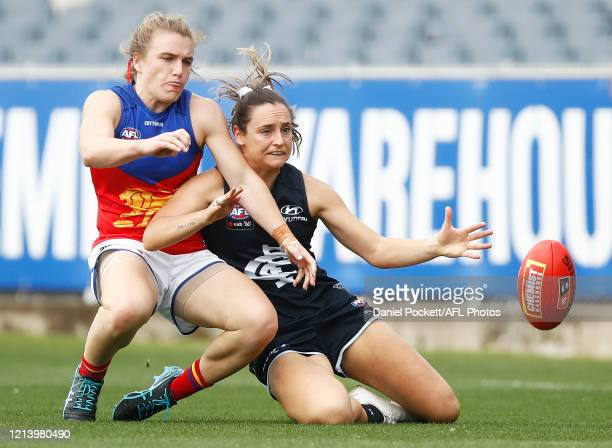 Nicola Stevens of the Blues and Maria Moloney of the Lions contest the ball during the AFLW Semi Final match between the Carlton Blues and the...