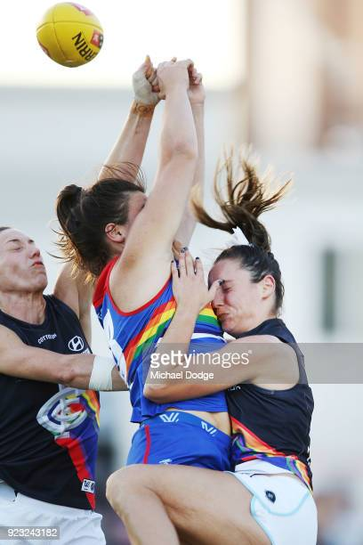Nicola Stevens of the Blues is crunched by Boonie Toogood of the Bulldogs during the round four AFLW match between the Western Bulldogs and the...