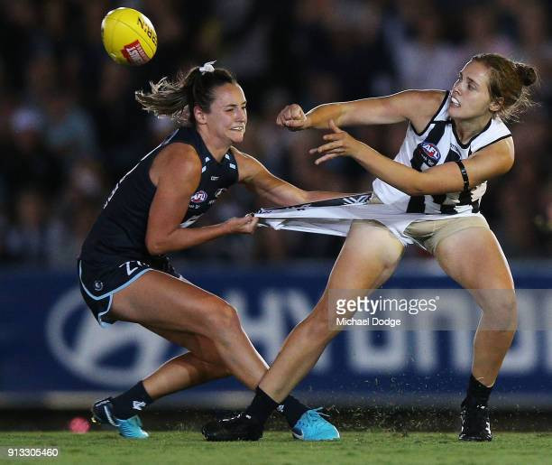 Nicola Stevens of the Blues tackles Jasmine Garner of the Magpies during the round one AFLW match between the Carlton Blues and the Collingwood...