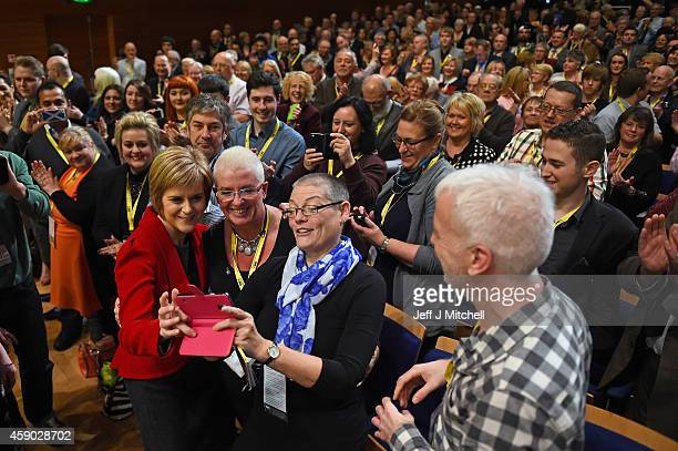 Nicola Sturgeon acknowledges applause following her first key note speech as SNP party leader at the party's annual conference on November 15 2014 in...