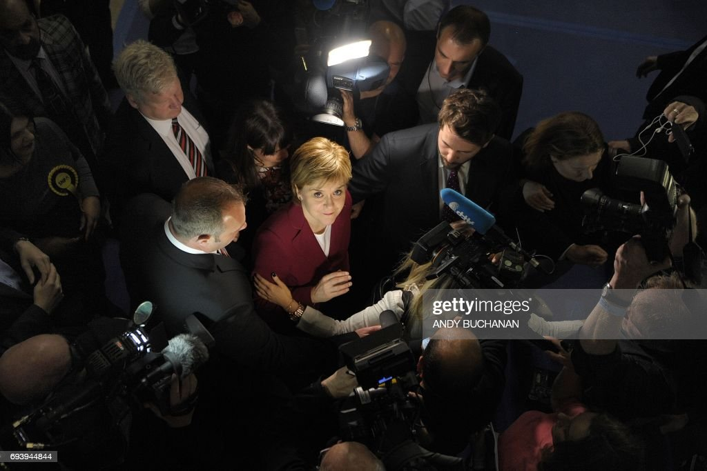 TOPSHOT - Nicola Sturgeon, First Minister of Scotland and leader of the Scottish National Party (SNP) arrives at the main Glasgow counting centre in Glasgow, Scotland, on June 9, 2017, hours after the polls closed in Britain's general election. Prime Minister Theresa May is poised to win Britain's snap election but lose her parliamentary majority, a shock exit poll suggested June 8, in what would be a major blow for her leadership as Brexit talks loom. / AFP PHOTO / Andy Buchanan