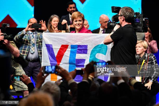 Nicola Sturgeon First Minister of Scotland and leader of the SNP holds a Yes flag following her address to the party autumn conference on October 15...