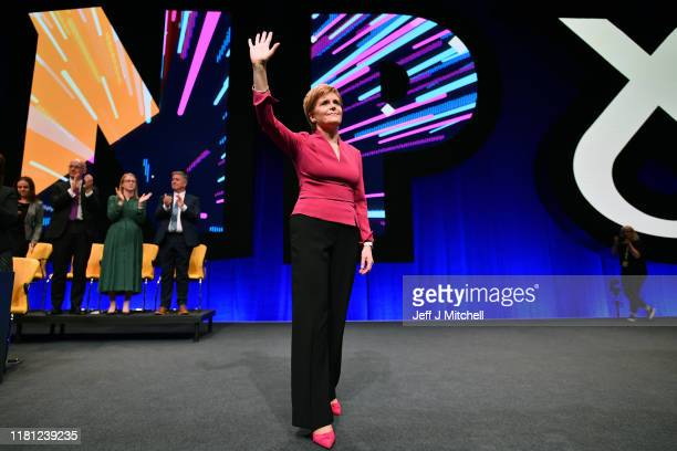 Nicola Sturgeon First Minister of Scotland and leader of the SNP takes applauds following her address to the party autumn conference on October 15...
