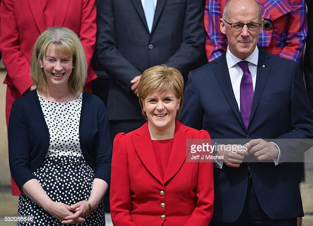 Nicola Sturgeon First Minister of Scotland Shona Robison Health Secretary and John Swinney deputy First Minister stand on the steps of Bute House as...