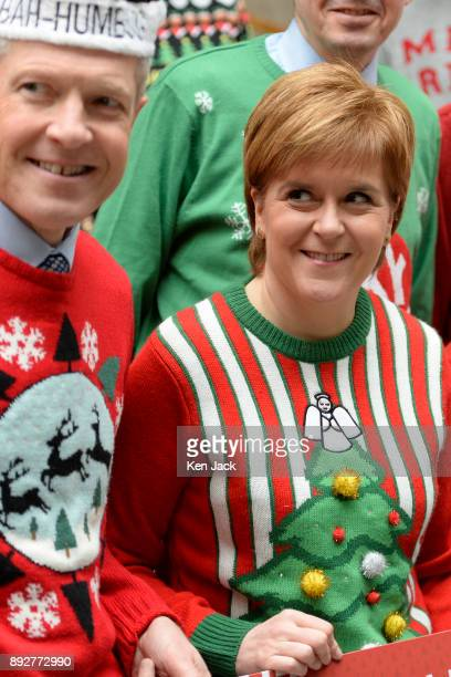 Nicola Sturgeon glances up at Scottish Liberal Democrat leader Willie Rennie's 'BahHumbug' hat as they and other Scottish party leaders sport...