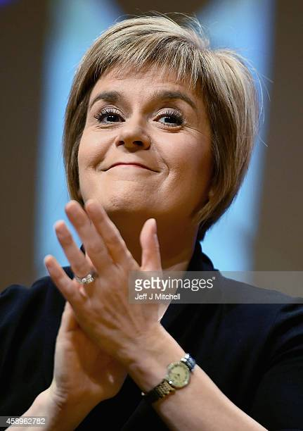 Nicola Sturgeon is formally announced as the new leader of the SNP listens to Stewart Hosie MP who replaces her as deputy leader at the party's...