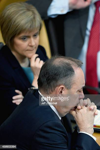 Nicola Sturgeon looks on as First Minister of Scotland Alex Salmond takes his last First Minister's Questions at the Scottish Parliament on November...