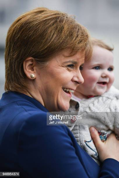 Nicola Sturgeon meets a young child as she departs from the Scottish Trade Union Congress on March 16 2018 in Aviemore Scotland Trade Unionists are...