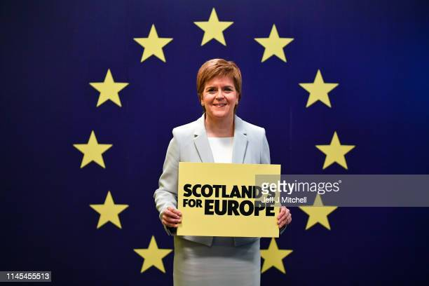 Nicola Sturgeon SNP leader and First Minister of Scotland stands with a placard during day one of the SNP Spring Conference at the Edinburgh...