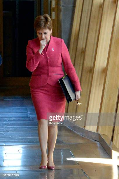 Nicola Sturgeon stifles a cough on her way to First Minister's Questions in the Scottish Parliament on October 5 2017 in Edinburgh Scotland