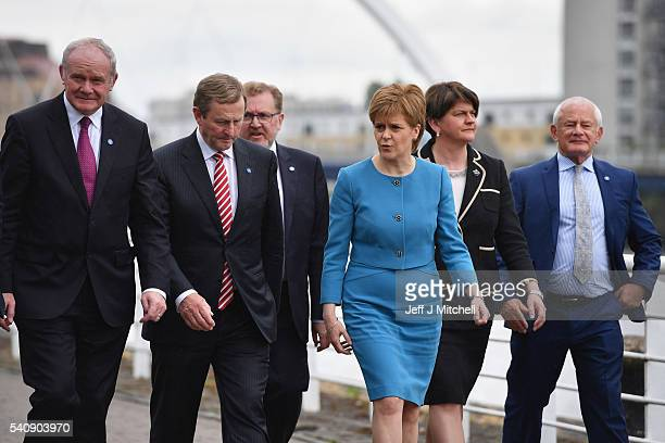 Nicola Sturgeon the First Minister of Scotland walks with Martin McGuinness deputy First Minister of Northern Ireland Taoiseach Enda Kenny Arlene...