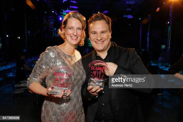 Nicola Surholt and host Guido Maria Kretzschmer pose with her awards during the Glammy Award 2017 on March 2, 2017 in Munich, Germany.