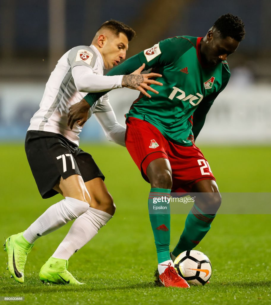 Nicola Trujic (L) of FC Tosno and Eder of FC Lokomotiv Moscow vie for the ball during the Russian Football League match between FC Tosno and FC Lokomotiv Moscow on December 11, 2017 at Petrovsky Stadium in Saint Petersburg, Russia.