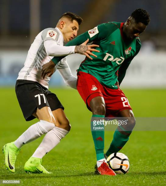 Nicola Trujic of FC Tosno and Eder of FC Lokomotiv Moscow vie for the ball during the Russian Football League match between FC Tosno and FC Lokomotiv...