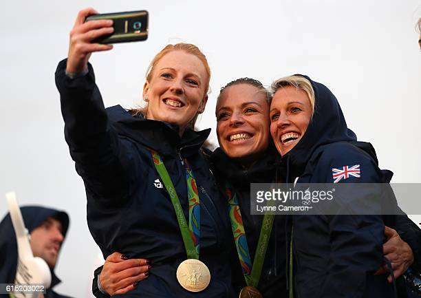 Nicola White Kate RichardsonWalsh and Alex Danson of Great Britain take a picture during a Rio 2016 Victory Parade for the British Olympic and...