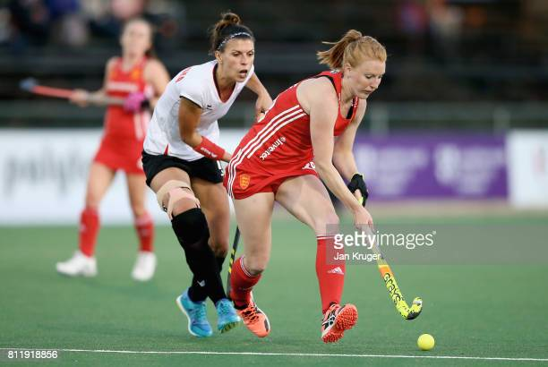 Nicola White of England and Natalia Wisniewska of Poland battle for possession during day 2 of the FIH Hockey World League Semi Finals Pool A match...