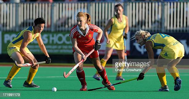 Nicola White of England attacks during the Investec Hockey World League Final match between England and Australia at The University of Westminster...