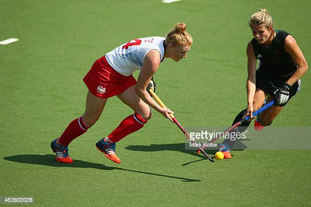 Nicola White of England runs the ball foward during the Women's preliminary match between England and Wales at Glasgow National Hockey Centre during...