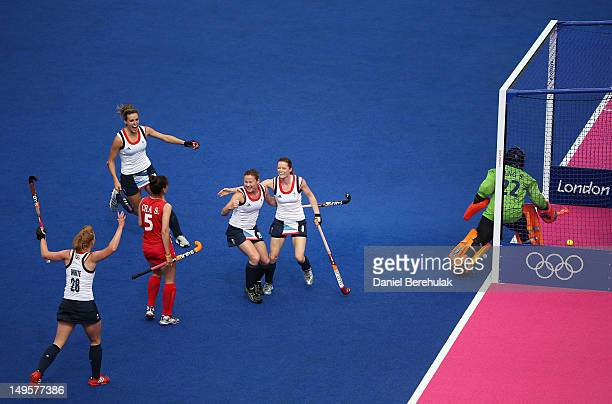 Nicola White of Great Britain celebrates scoring during the Women's Hockey Match between Great Britain and Korea on day 4 of the London 2012 Olympic...