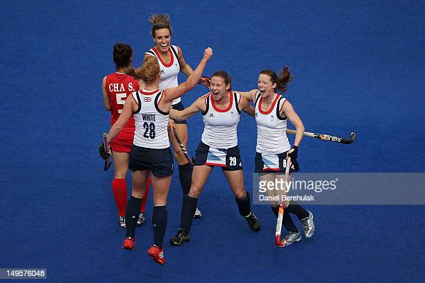 Nicola White of Great Britain celebrates scoring with her teammates during the Women's Hockey Match between Great Britain and Korea on day 4 of the...