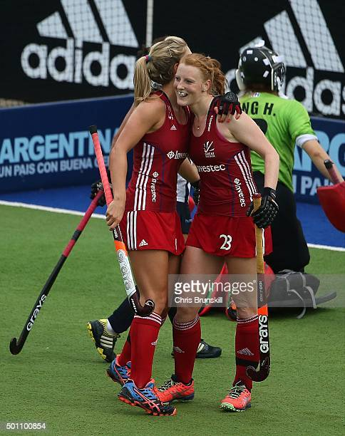 Nicola White of Great Britain is congratulated by her teammate Alex Danson after scoring against Korea during Day 8 of the Hockey World League Final...