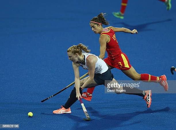 Nicola White of Great Britain stretches for the ball as Rocio Ybarra challenges during the Women's quarter final hockey match between Great Britain...