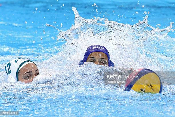Nicola Zagame of Australia and Rita Keszthelyi of Hungary battle for the ball on Day 10 of the 2016 Rio Olympics at Olympic Aquatics Stadium during...