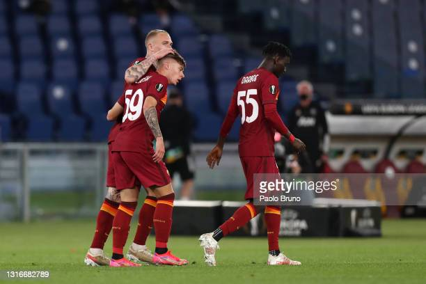 Nicola Zalewski of A.S Roma celebrates with team mate Rick Karsdorp after their side's third goal, an own goal scored by Alex Telles of Manchester...