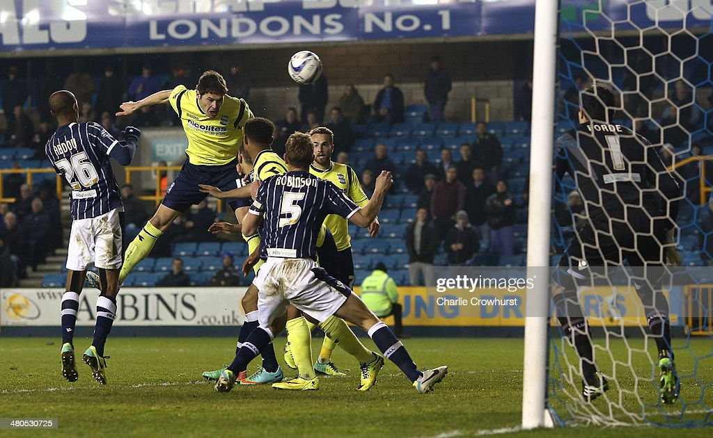 Nicola Zigic of Birmingham (2nd L) scores their third goal of the game during the Sky Bet Championship match between Millwall and Birmingham City at The Den on March 25, 2014 in London, England.