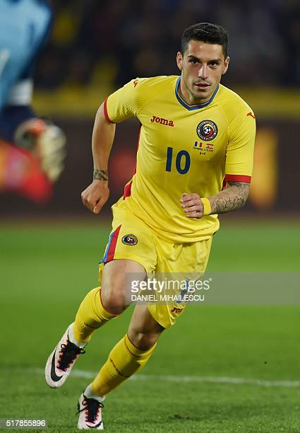 Nicolae Claudiu Stanciu of Romania runs during the friendly football match between Romania and Spain in Cluj Napoca Romania on March 27 2016 / AFP /...
