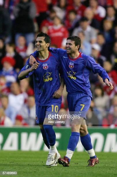 Nicolae Dica of Steaua Bucharest celebrates scoring the opening goal with team mate Daniel Oprita during the UEFA Cup Semi Final second leg match...