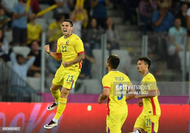 TOPSHOT Nicolae Stanciu of Romania celebrates after he scored 22 against Chile during their international friendly football matchbetween Romania and...