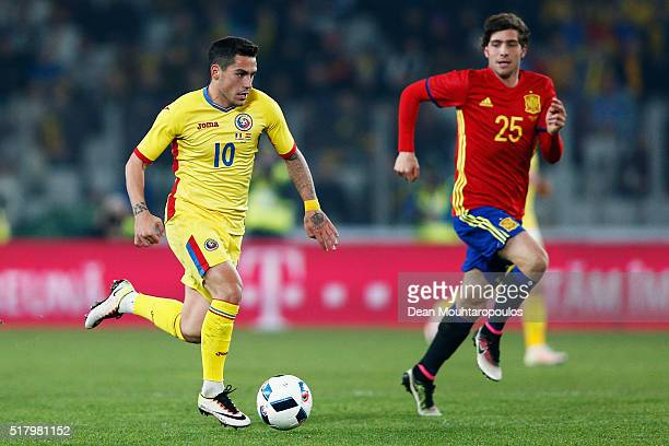 Nicolae Stanciu of Romania gets past Sergi Roberto of Spain during the International Friendly match between Romania and Spain held at the Cluj Arena...