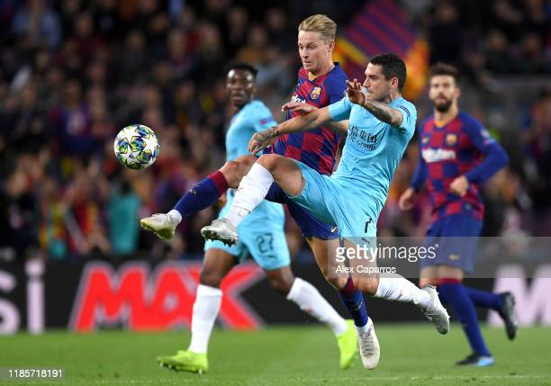 Nicolae Stanciu of Slavia Praha battles for possession with Frenkie de Jong of FC Barcelona during the UEFA Champions League group F match between FC...