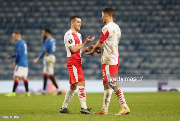 Nicolae Stanciu of Slavia Praha celebrates with Alexander Bah after scoring their side's second goal with during the UEFA Europa League Round of 16...