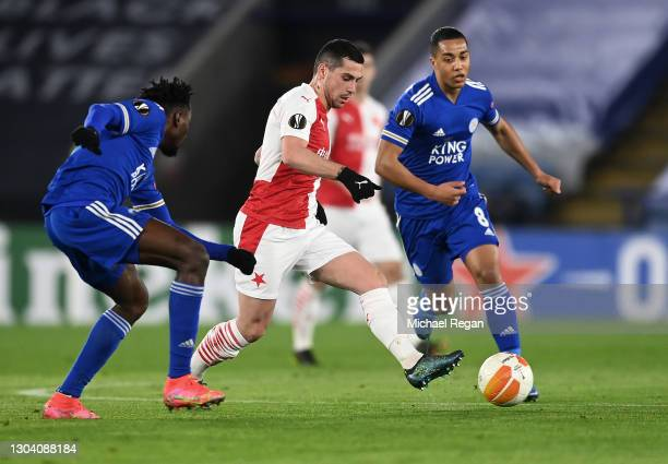 Nicolae Stanciu of Slavia Praha is challenged by Wilfred Ndidi of Leicester City and Youri Tielemans of Leicester City during the UEFA Europa League...