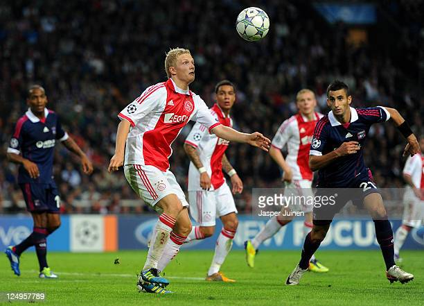Nicolai Boilesen of Ajax controls the ball besides Maxime Gonalons of Olympique Lyonnais during the UEFA Champions League group D match between AFC...