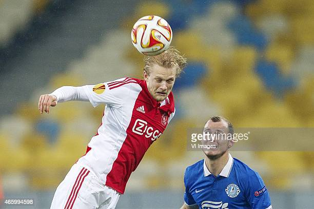 Nicolai Boilesen of Ajax Roman Zozulya of FC Dnipro Dnipropetrovsk during the Europa League round of 16 match between FC Dnipro Dnipropetrovsk and...