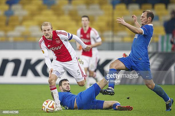 Nicolai Boilesen of Ajax Yevhen Shakhov of FC Dnipro Dnipropetrovsk Roman Zozulya of FC Dnipro Dnipropetrovsk during the Europa League round of 16...