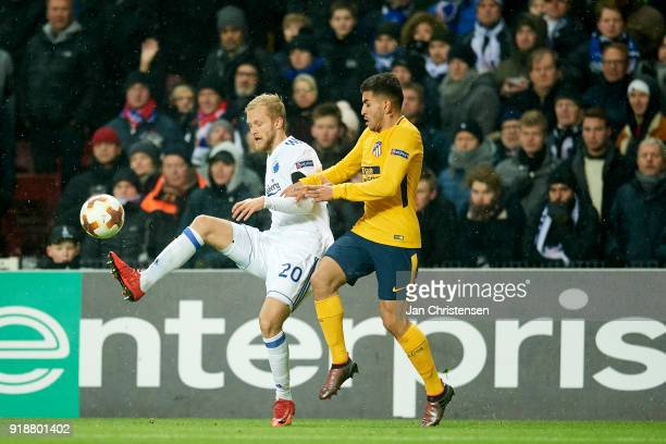 Nicolai Boilesen of FC Copenhagen and Angel Correa of Atlético Madrid compete for the ball during the UEFA Europa League match between FC Copenhagen...