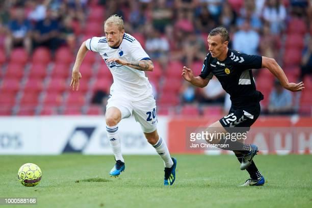 Nicolai Boilesen of FC Copenhagen and Martin Pusic of AC Horsens in action during the Danish Superliga match between FC Copenhagen and AC Horsens at...