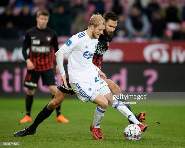 Nicolai Boilesen of FC Copenhagen and Tim Sparv of FC Midtjylland compete for the ball during the Danish Alka Superliga match between FC Midtjylland...
