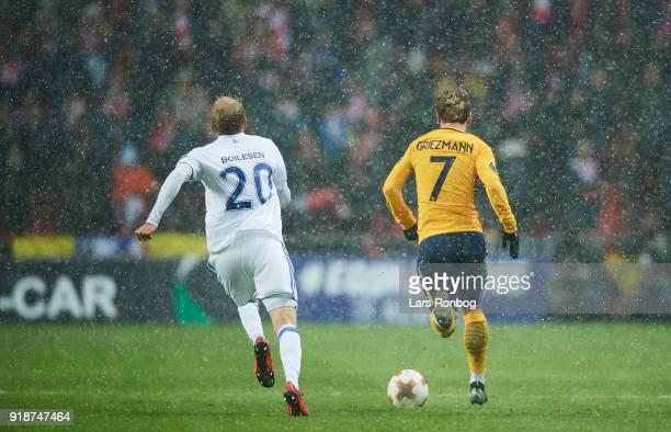 Nicolai Boilesen of FC Copenhagen chasing Antoine Griezmann of Club Atletico de Madrid during the UEFA Europa League round of 32 1 leg match between...